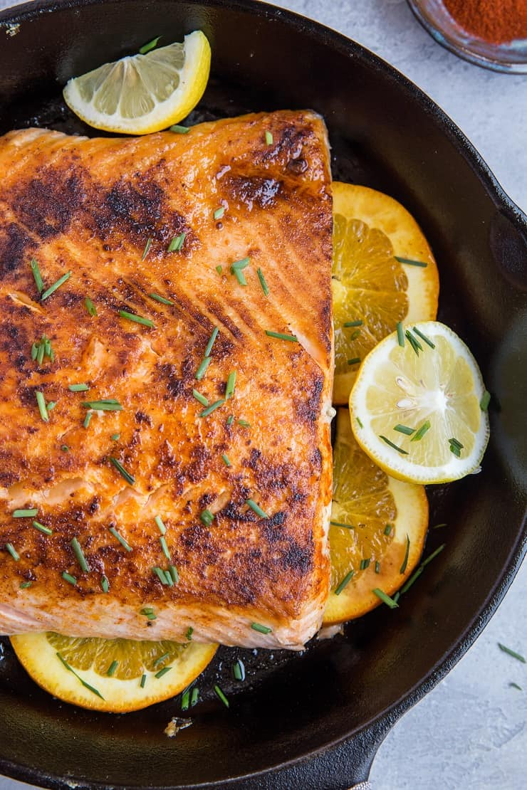 Paleo Low-Carb Lemon Salmon with orange and ghee sauce. This healthy salmon recipe is easy to prepare and absolutely delicious!
