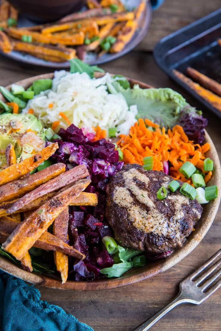 Burger Bowls with Chipotle Sauce, sauerkraut, pickled beets, carrots, mixed greens and avocado - a nutritious approach to hamburgers! These bowls are a healthy dinner option and are easy to make any night of the week!