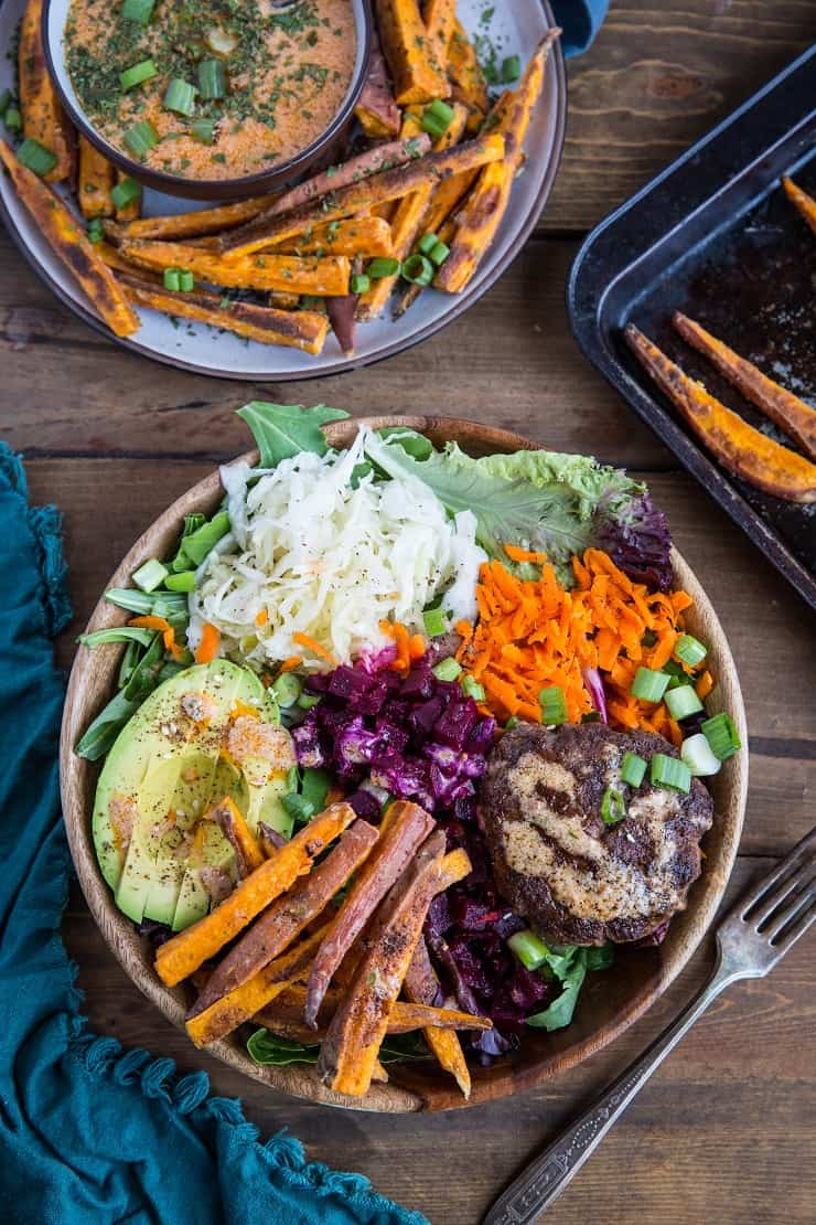 Burger Bowls with Chipotle Sauce, sauerkraut, pickled beets, carrots, mixed greens and avocado - a nutritious approach to hamburgers!