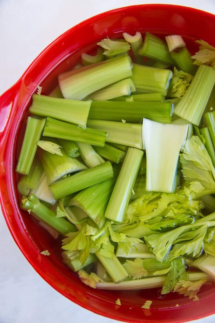 Celery soaking in apple cider vinegar and water