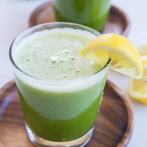 Happy Digestion Celery Juice - home-juiced celery juice with cucumber, orange and lemon for the ultimate healthy gut elixir. | TheRoastedRoot.net #greenjuice #detox #vegan