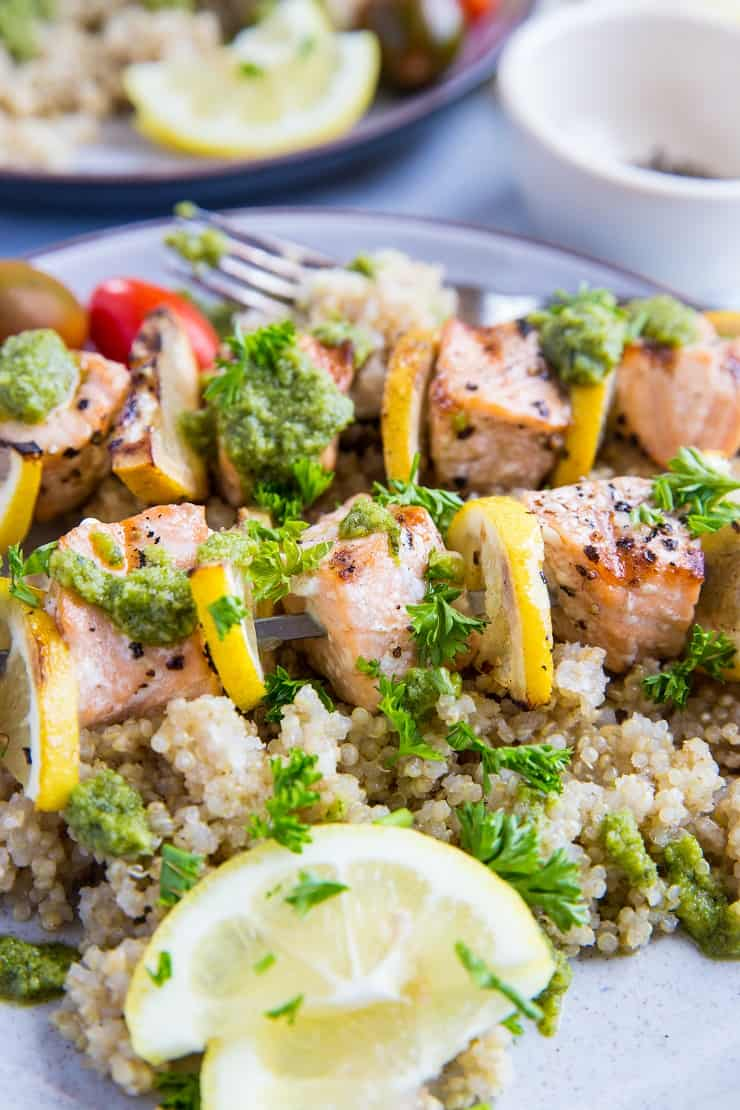 Grilled Salmon Kabobs with pesto sauce and quinoa - a quick, easy, nutritious meal | TheRoastedRoot.com #glutenfree #paleo #primal #healthy