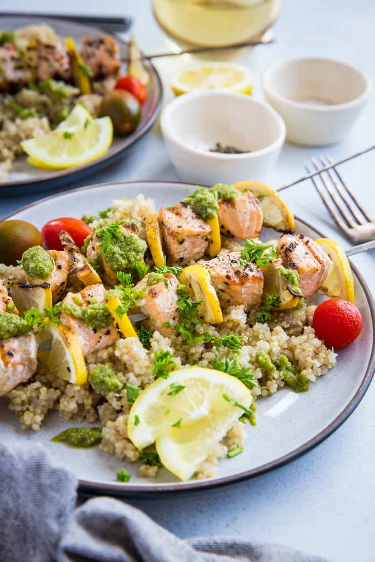 Quick and Easy Grilled Salmon Kabobs with pesto sauce and quinoa - a deliciously healthy clean meal | TheRoastedRoot.net #glutenfree #paleo #primal