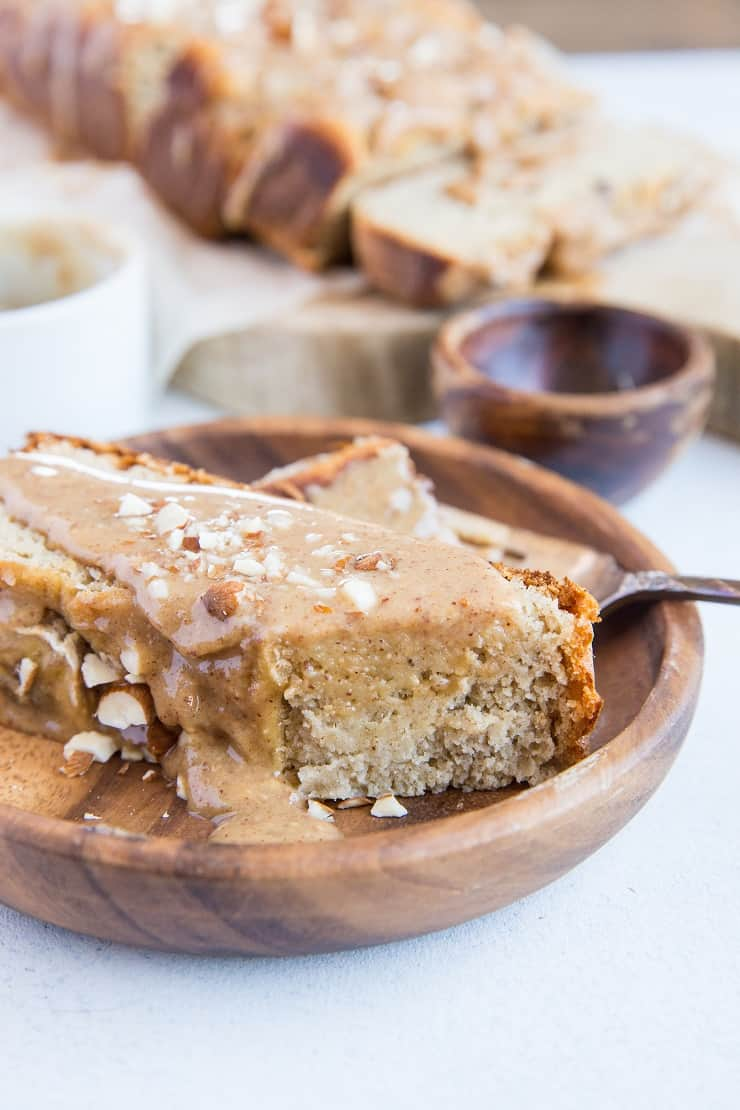 Paleo Banana Bread with Almond Butter Glaze - a deliciously moist and fluffy grain-free banana bread recipe that is dairy-free and refined sugar-free. The almond butter glaze is sinfully delicious | TheRoastedRoot.com