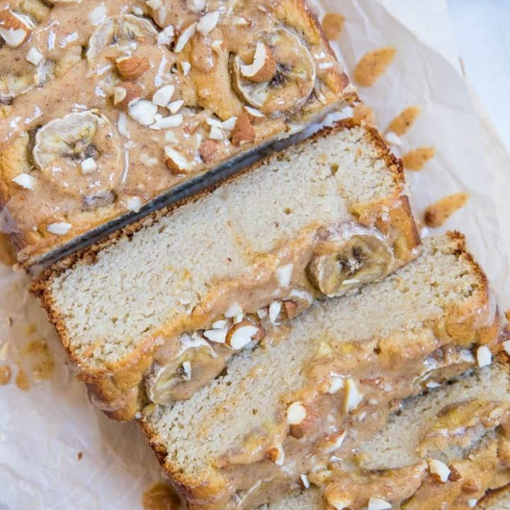Paleo Banana Bread with Almond Butter Glaze - a deliciously moist and fluffy grain-free banana bread recipe that is dairy-free and refined sugar-free. The almond butter glaze is a MUST!