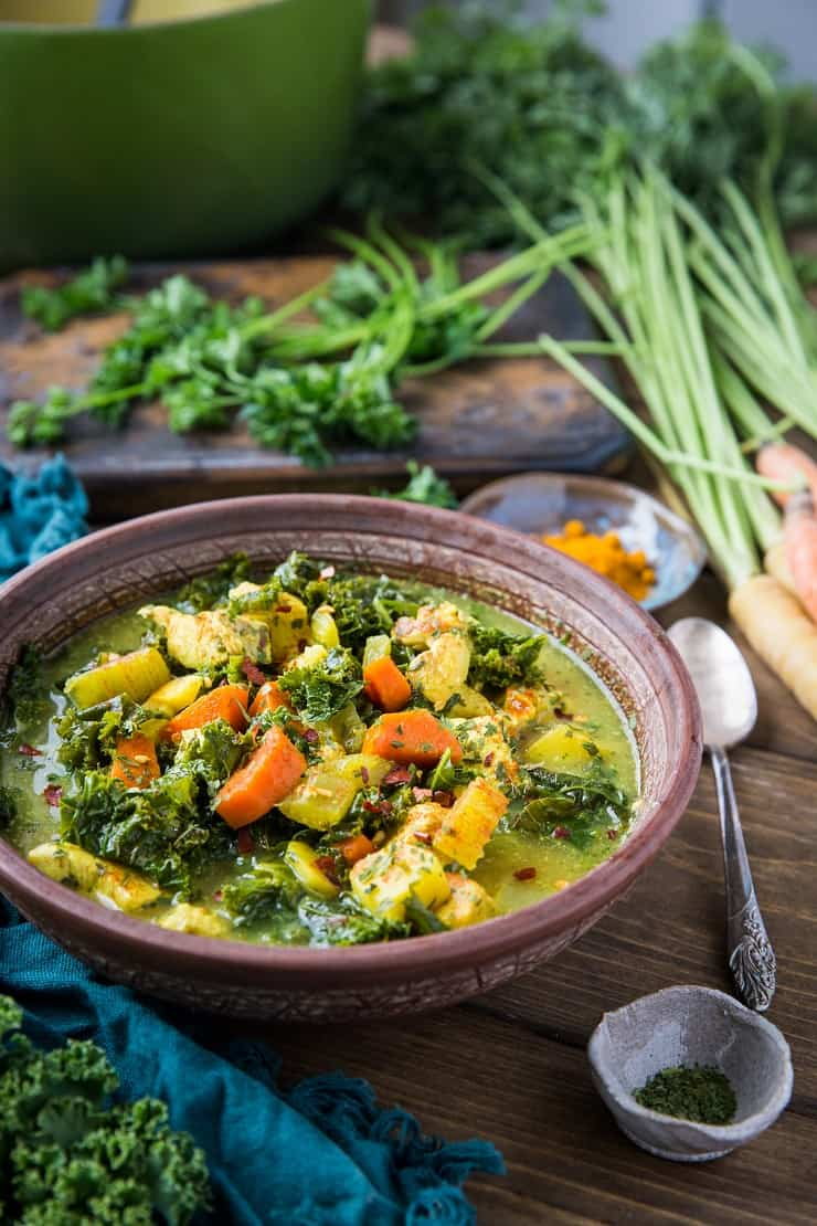 Superfood Immunity-Boosting Turmeric Chicken Soup with ginger, bone broth, kale, carrots, and parsley. This nutrient-dense meal is paleo, keto, and whole30 | TheRoastedRoot.com #glutenfree