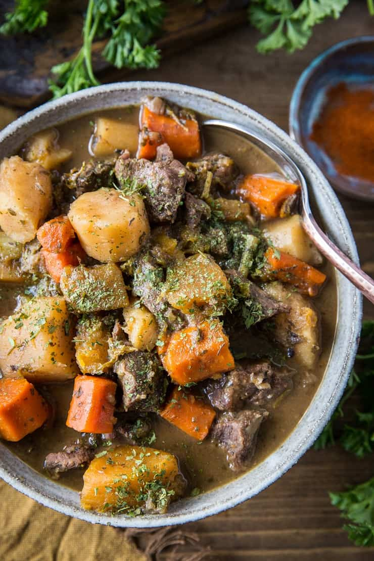Paleo Instant Pot Beef Stew with parsnips, carrots, butternut squash. A potato-free stew recipe that is paleo, whole30, and AIP-friendly | TheRoastedRoot.net #glutenfree