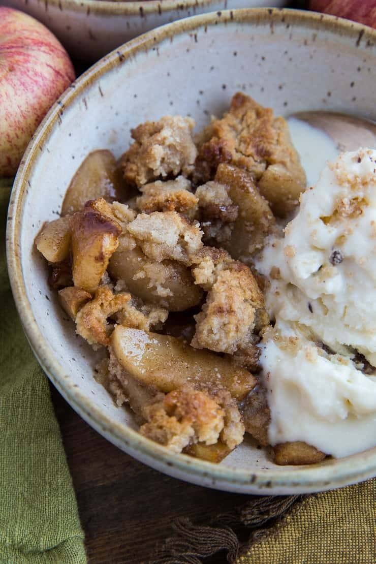 Paleo Vegan Apple Cinnamon Crisp - grain-free with an almond flour crust and refined sugar-free with pure maple syrup | TheRoastedRoot.net #dessert #healthy #glutenfree