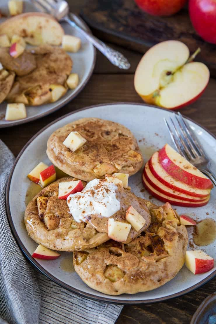 Paleo Apple Cinnamon Pancakes made with almond flour and tapioca flour. This super fluffy grain-free pancake recipe is a pure delight! | TheRoastedRoot.net #glutenfree #breakfast #healthy