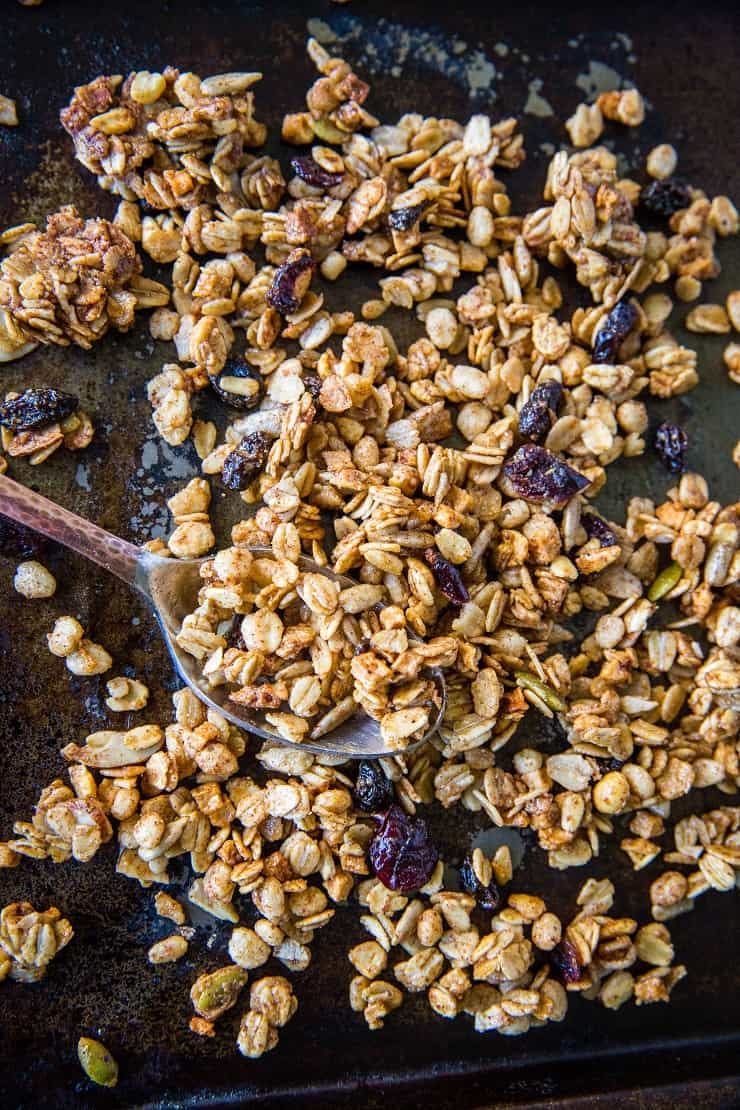 Gluten-Free Pumpkin Spice Granola with real pumpkin puree, pure maple syrup, nuts, and seeds. A marvelous fall and winter breakfast or snack | TheRoastedRoot.net #healthy #breakfast #recipe