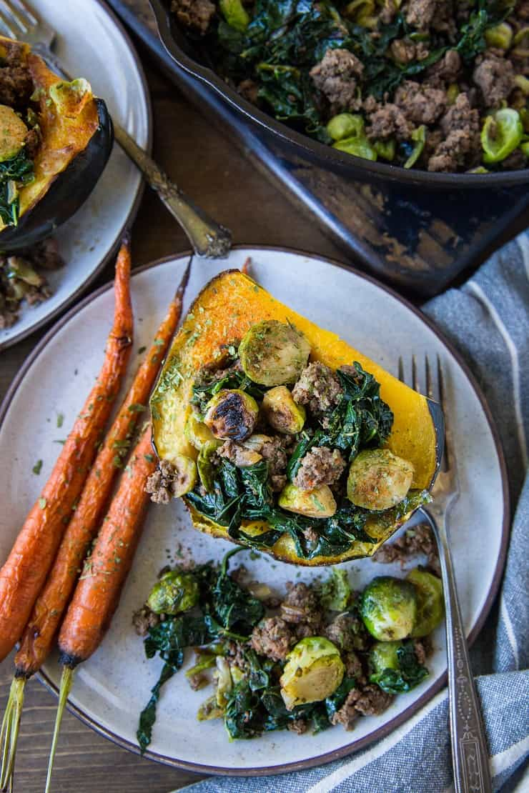 Stuffed Acorn Squash with Ground Beef, Brussels Sprouts, and Kale - a clean, nutritious dinner recipe that's paleo, low-carb, and whole30 | TheRoastedRoot.net #glutenfree