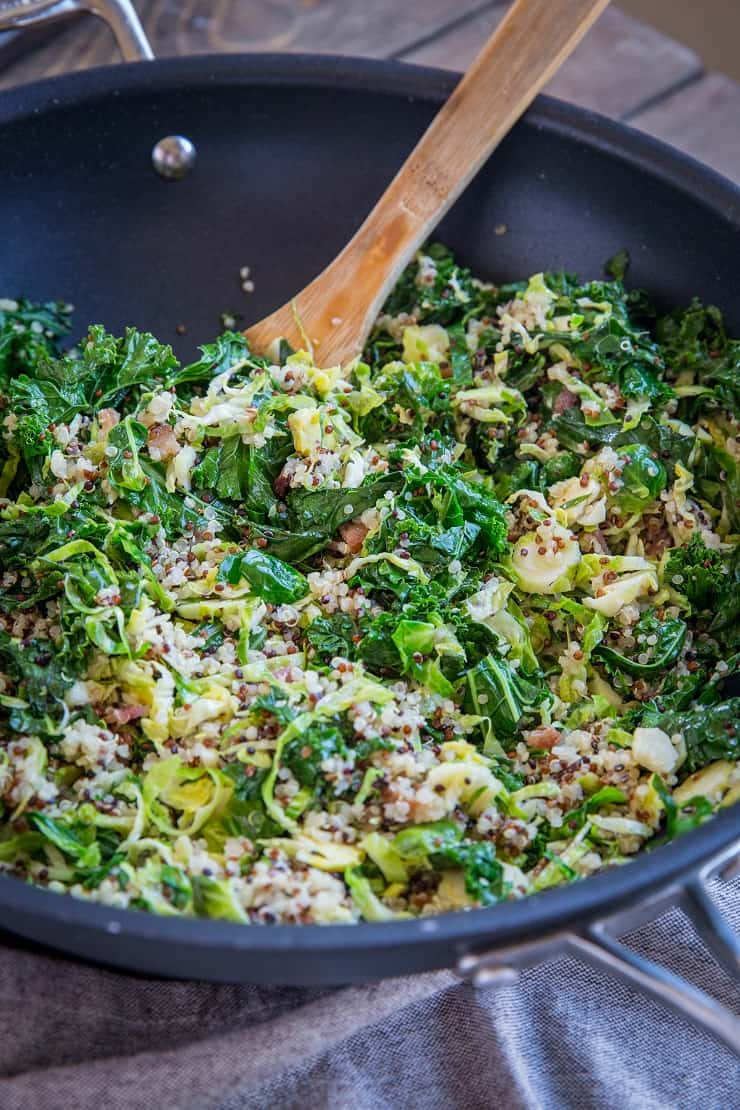 Warm Brussles Sprouts Salad with Kale, Quinoa, Pears, and Bacon Vinaigrette - an incredibly nutritious salad or side dish to share with friends and family | TheRoastedRoot.com #glutenfree #healthyrecipe