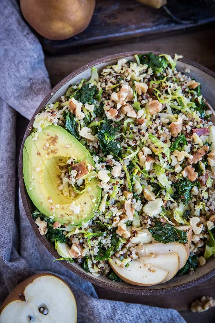 Warm Brussles Sprouts Salad with Kale, Quinoa, Pears, and Bacon Vinaigrette - an incredibly nutritious salad or side dish to share with friends and family   TheRoastedRoot.com #glutenfree #healthyrecipe