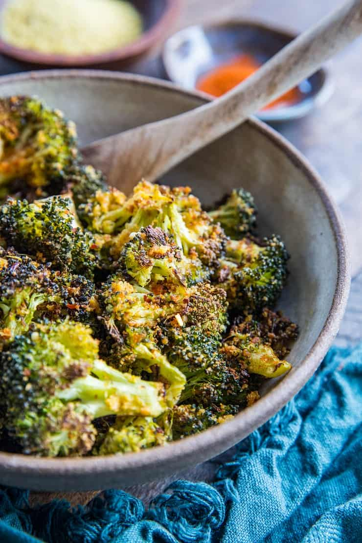 """Cheesy"" Vegan Roasted Broccoli - a vegan approach to cheesy broccoli using nutritional yeast in place of cheese 