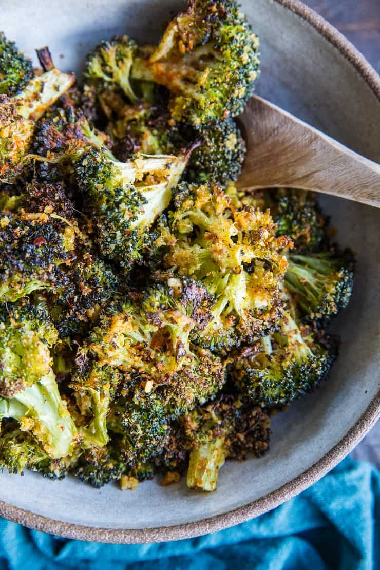 """Cheesy"" Vegan Crispy Broccoli - an easy dairy-free roasted broccoli recipe that has a lovely cheesy flavor from nutritional yeast 