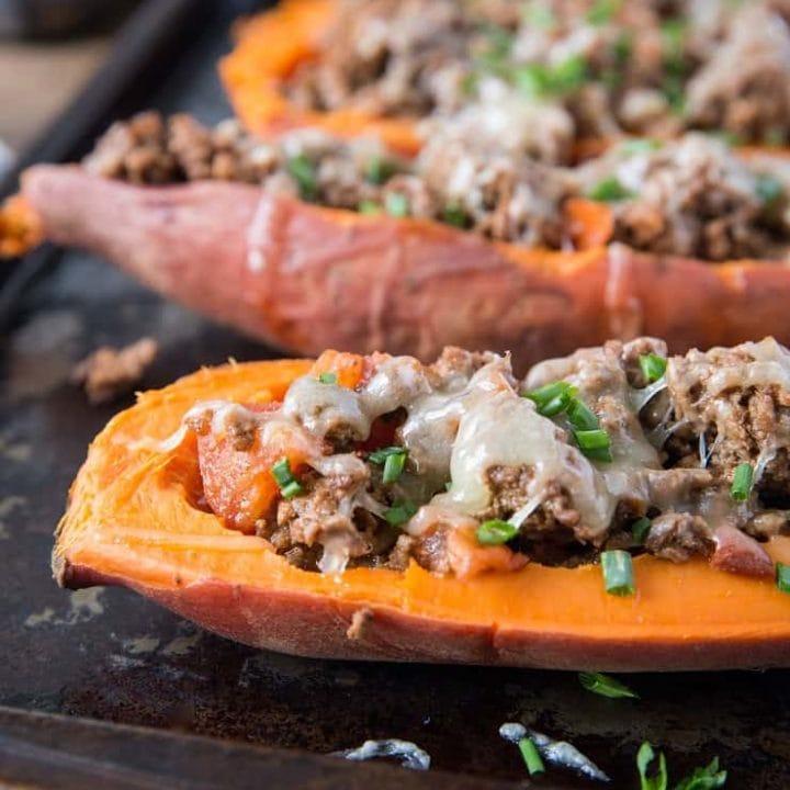 Taco-Stuffed Sweet Potatoes - an easy, healthy dinner recipe | TheRoastedRoot.net #glutenfree