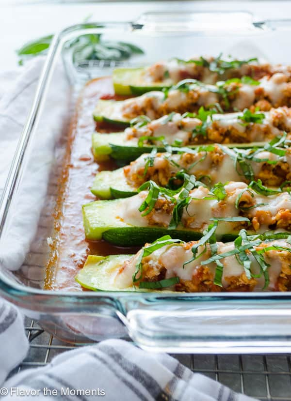 Chicken Parmesan Stuffed Zucchini Boats + 65 Keto Recipes | TheRoastedRoot.net #lowcarb #keto