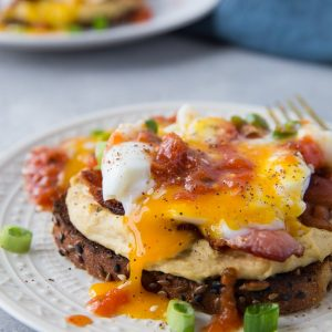 Huevos Rancheros Hummus Toast with soft boiled egg, bacon, and salsa | TheRoastedRoot.net #hummustoast #breakfast