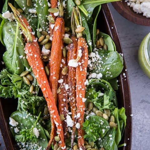 Roasted Carrot Spinach Salad with Lemon Herb Dressing - a simple clean salad that is primal and keto.   TheRoastedRoot.net #cleaneating #vegetarian #glutenfree