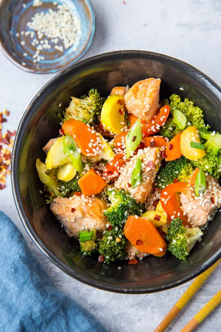 Salmon Stir Fry with Vegetables - an easy paleo, keto, whole30 dinner recipe that only requires 30 minutes to make!   TheRoastedRoot.net #glutenfree