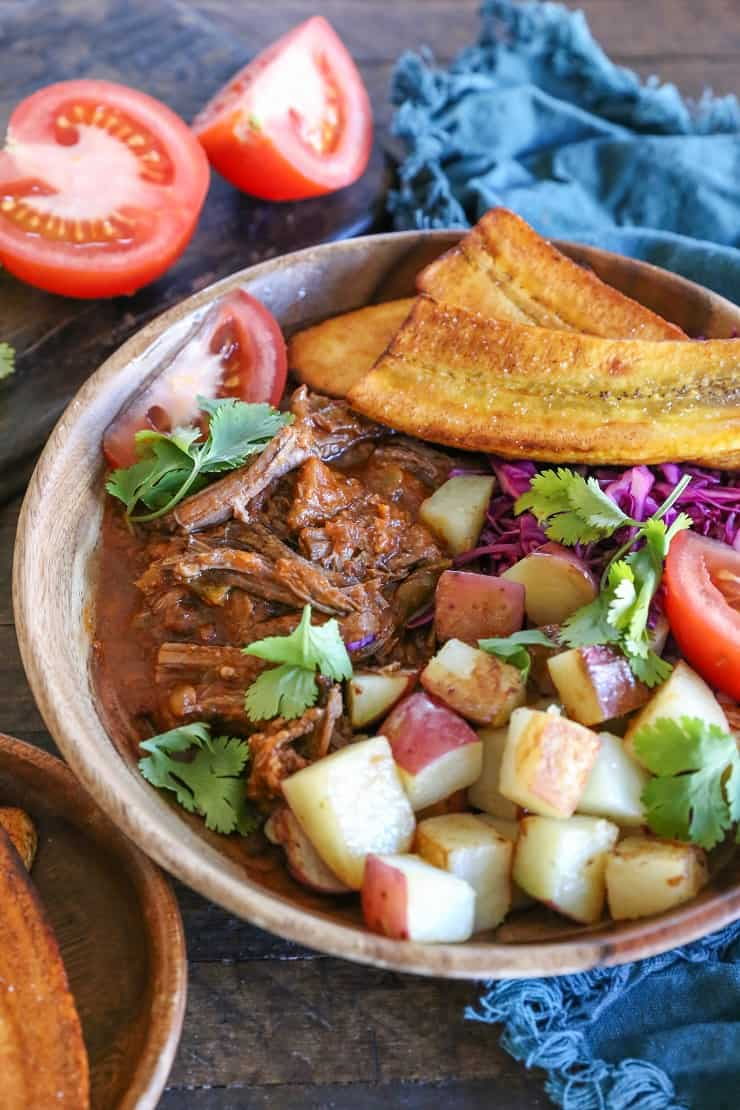 Slow Cooker Ropa Vieja (Cuban Shredded Beef) with Instant Pot instructions. This delicious flavorful dish is paleo, whole30, and versatile! | TheRoastedRoot.net #glutenfree