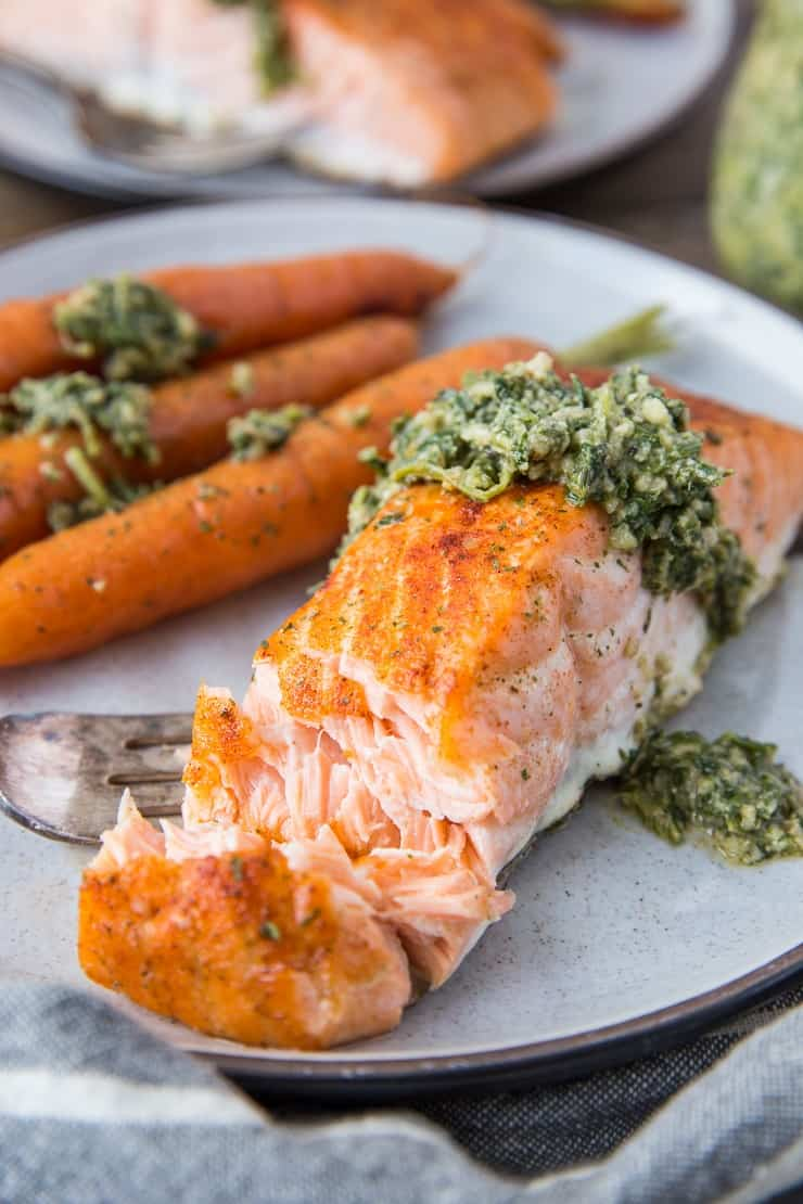 Sheet Pan Salmon and Carrots with Carrot Top Pesto - a whole30, paleo, keto diner recipe that requires just 35 minutes to make! | TheRoastedRoot.net
