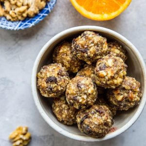 Cranberry Orange Protein Balls - healthy paleo-friendly snack made with nuts, seeds, orange zest, dates, and dried cranberries | TheRoastedRoot.net