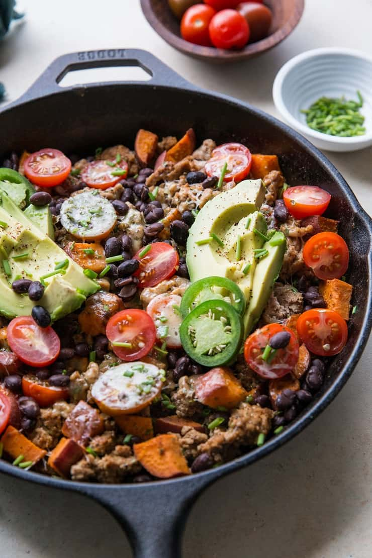 Ground Turkey Taco Skillet with sweet potato, black beans, tomatoes, and avocado - a healthy 30-minute meal! | TheRoastedRoot.net