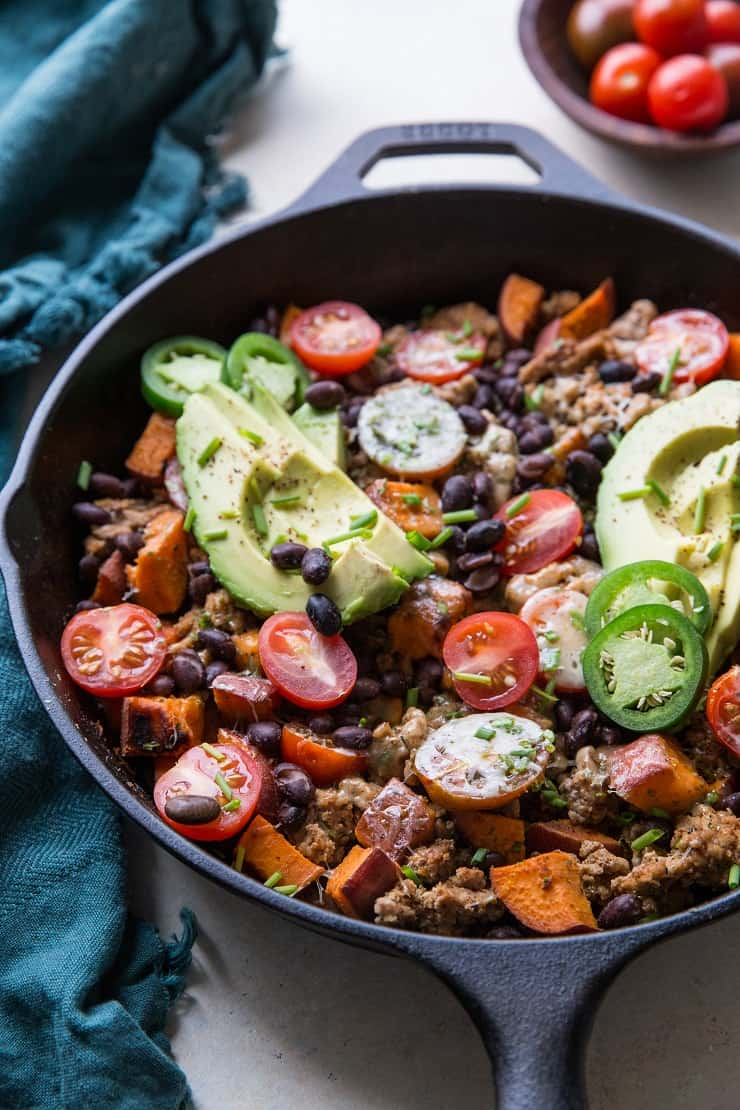 Ground Turkey Taco Skillet with black beans, sweet potato, tomatoes, cheese, avocados, and chives - an easy, clean, healthy dinner recipe ready in just 30 minutes | TheRoastedRoot.net