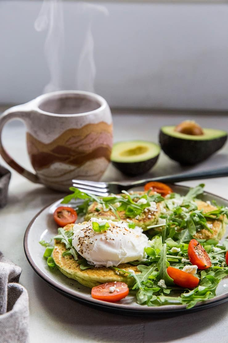 Paleo Avocado Pancakes - grain-free pancakes made with almond flour, almond milk, eggs, and avocado - an easy and delicious savory pancake recipe | TheRoastedRoot.net #paleo
