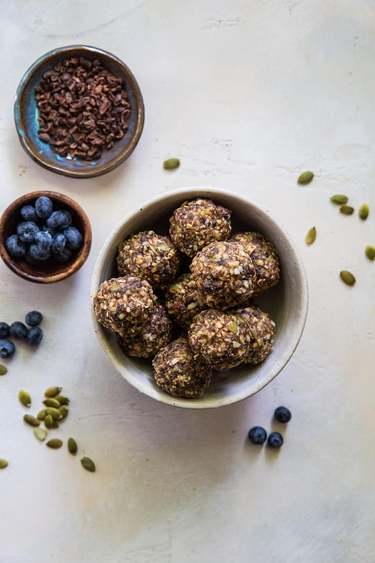 Superfood Blueberry Dark Chocolate Energy Balls made with walnuts, almonds, dates, flax seed oil, and more! A healthy snack recipe | TheRoastedRoot.net #paleo #vegan #healthy