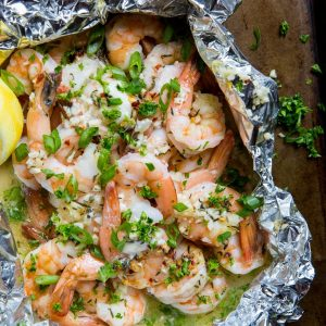 How to Grill Shrimp in Foil Packets - this easy lemon garlic butter shrimp recipe is quick to prepare!   TheRoastedRoot.net