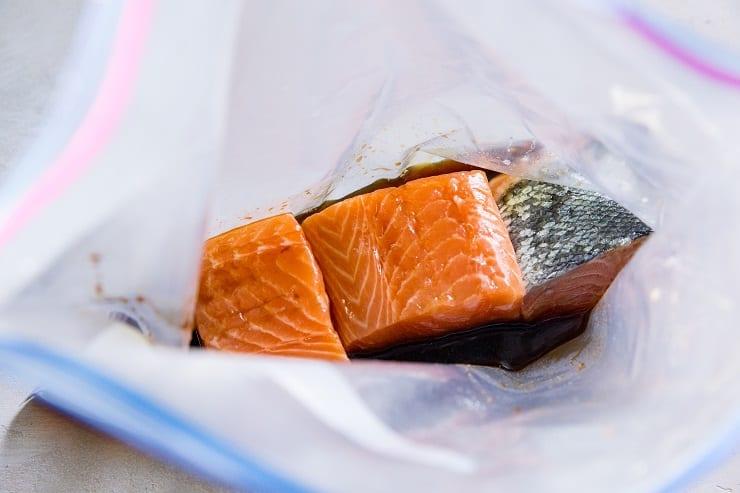 Teriyaki salmon marinating in sauce