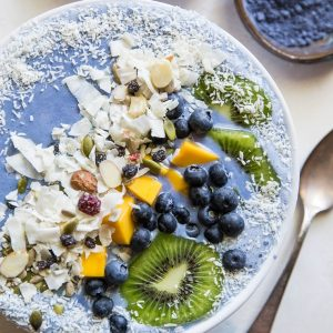 Tropical Blue Smoothie Bowl with mango, coconut, kiwi, and blueberries. Make a blue smoothie bowl with blue spirulina or blue pea powder for a healthy antioxidant packed breakfast | TheRoastedRoot.net