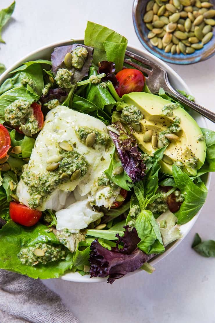 Cod Salad with Basil-Walnut Pesto, cherry tomatoes, pumpkin seeds and avocado - a low-carb, keto, paleo, whole30 dinner recipe | TheRoastedRoot.net