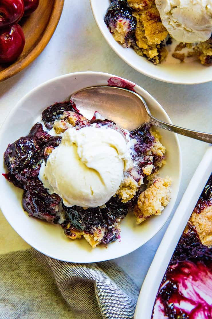 Gluten-Free Cherry Cobbler - refined sugar-free with a vegan and paleo option! An easy approach to classic delicious cherry cobbler | TheRoastedRoot.net