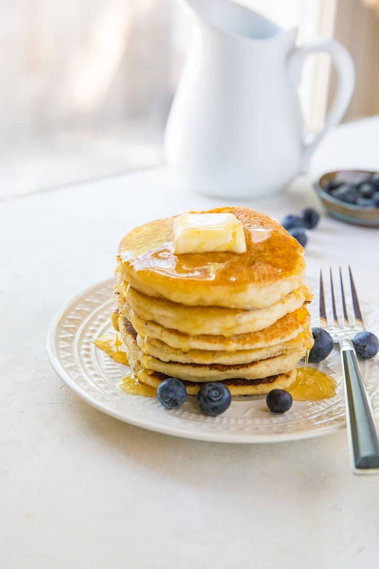Paleo vegan pancakes that are grain-free, dairy-free, and made with almond flour. This healthy gluten-free pancake recipe is made easily in your blender and results in fluffy, moist pancakes.