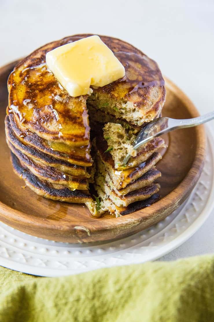 Grain-Free Coconut Flour Zucchini Pancakes - an easy paleo pancake recipe made in a blender! Fluffy, moist, delicious, healthy. | TheRoastedRoot.net #glutenfree