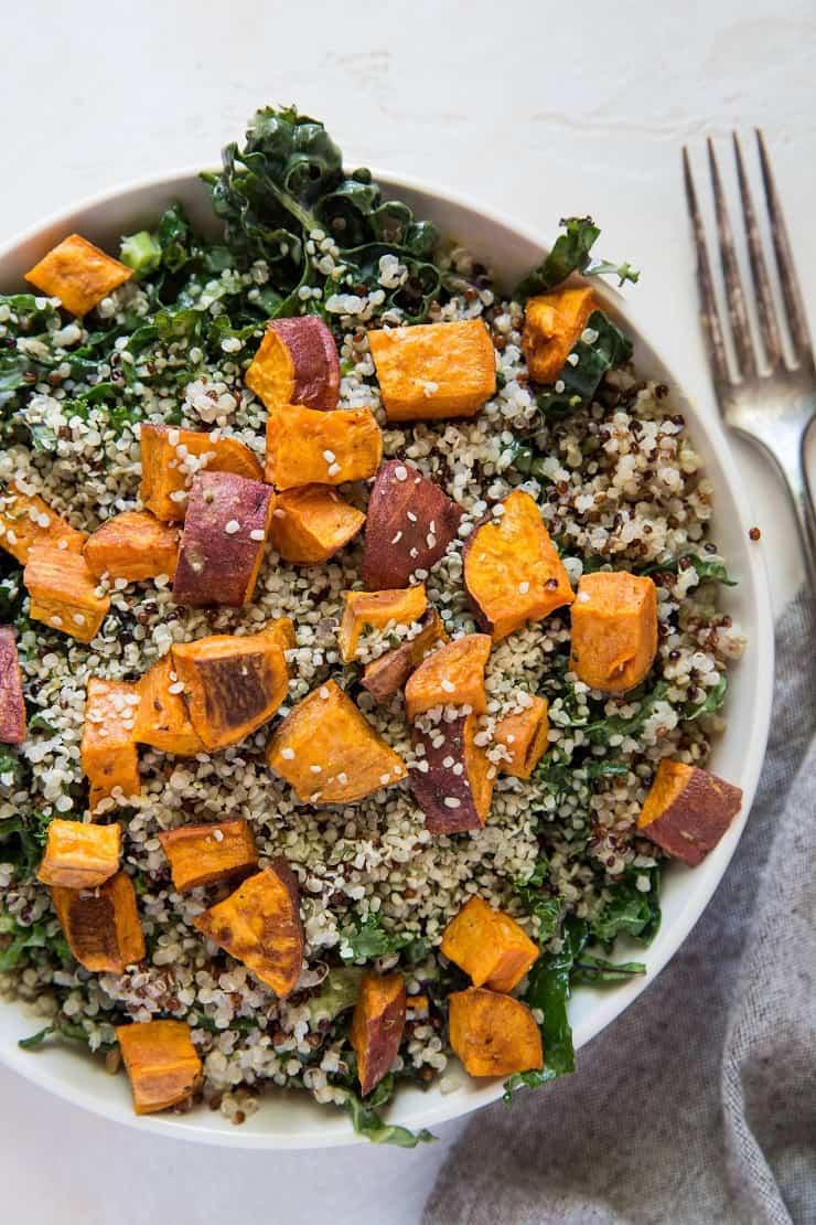 Roasted Sweet Potato Kale Salad with Quinoa, hemp seeds, and honey mustard dressing | TheRoastedRoot.net