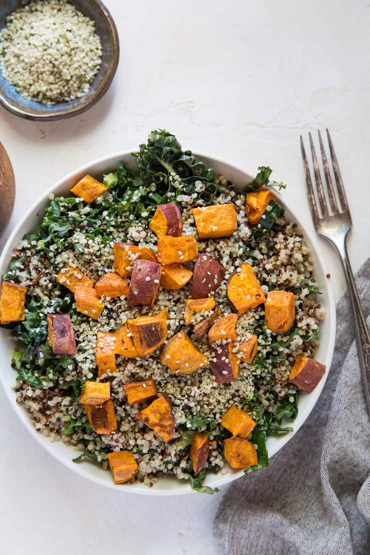 Roasted Sweet Potato Kale Salad with Quinoa, hemp seeds, and honey mustard dressing | TheRoastedRoot.net
