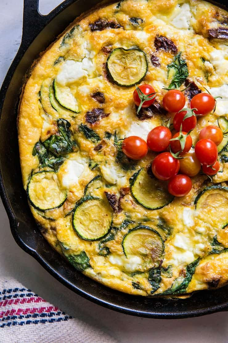 Spinach Frittata with Zucchini, Sun-Dried Tomatoes, and Goat Cheese - a healthy gluten-free breakfast recipe! | TheRoastedRoot.net