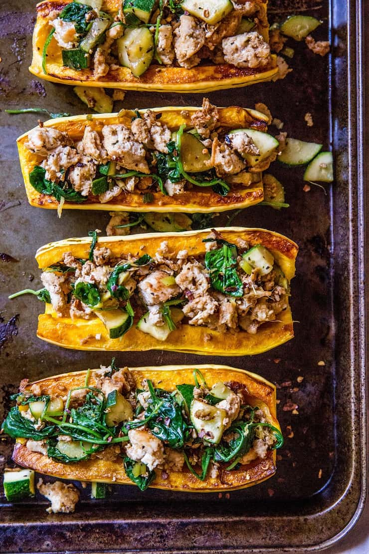 Ground Turkey Stuffed Delicata Squash with zucchini, spinach, ginger, and coconut aminos - paleo, whole30, keto, low-carb, and AIP dinner recipe! | TheRoastedRoot.net