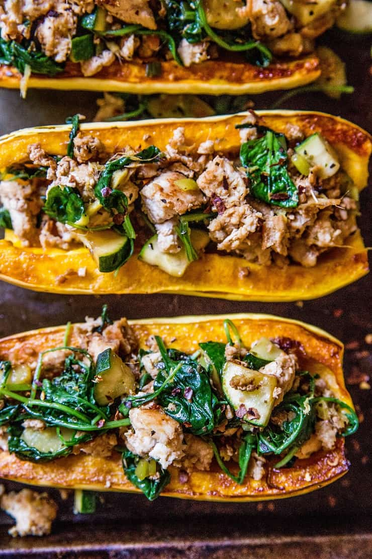 Ground Turkey Stuffed Delicata Squash with zucchini, spinach, ginger, and coconut aminos - paleo, whole30, Low-FODMAP, low-carb, and AIP dinner recipe! | TheRoastedRoot.net