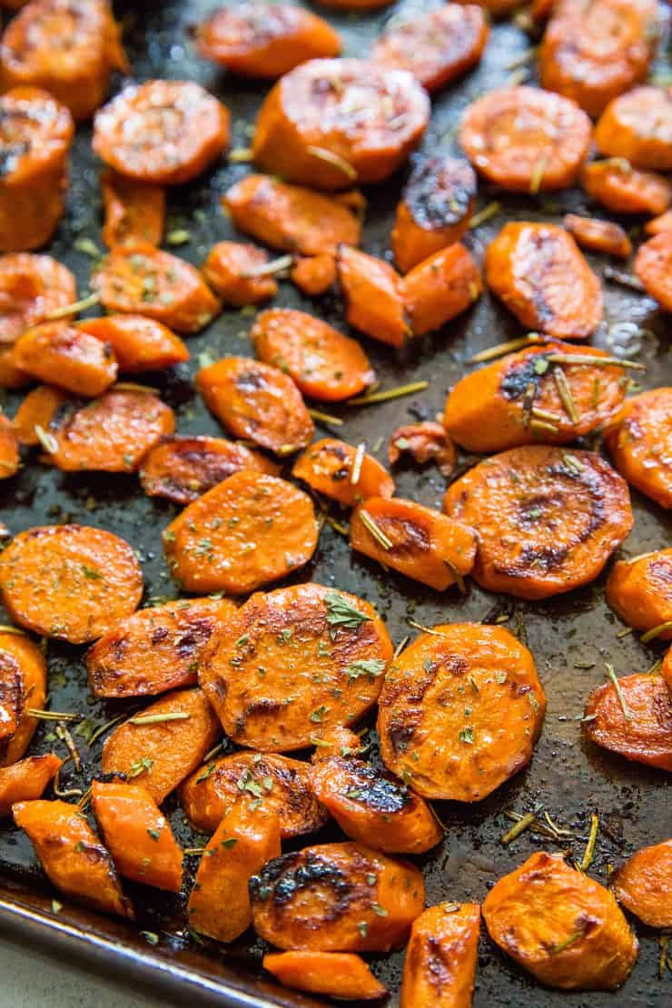 Apple Cider Glazed Roasted Carrots with pumpkin seeds and rosemary is a healthy holiday side dish | TheRoastedRoot.net