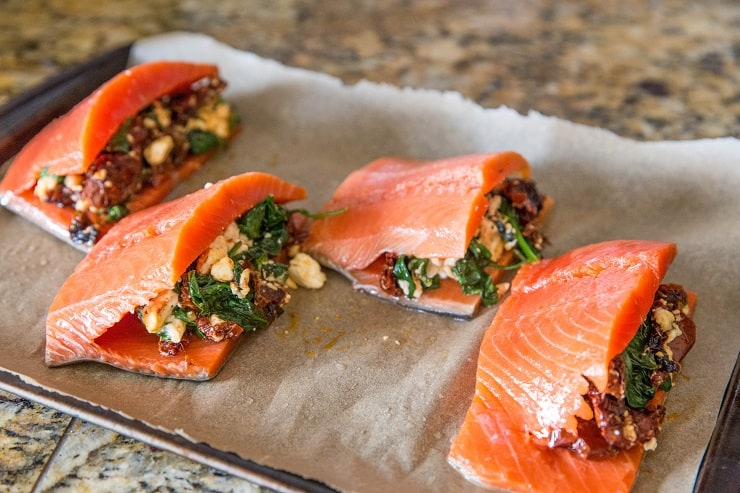 Salmon stuffed with sun-dried tomatoes, feta, and spinach