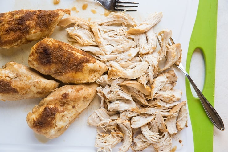 Pressure cooker shredded chicken on a cutting board