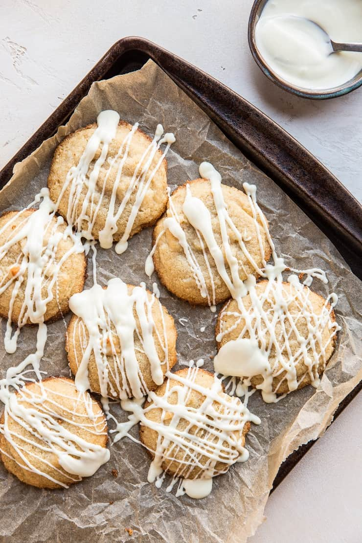 Top down photo of a tray of paleo white chocolate macadamia nut cookies