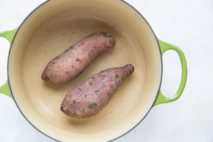 Boiled sweet potatoes in a pot