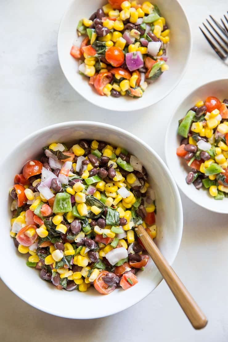 1 large and two small bowls of black bean corn salad