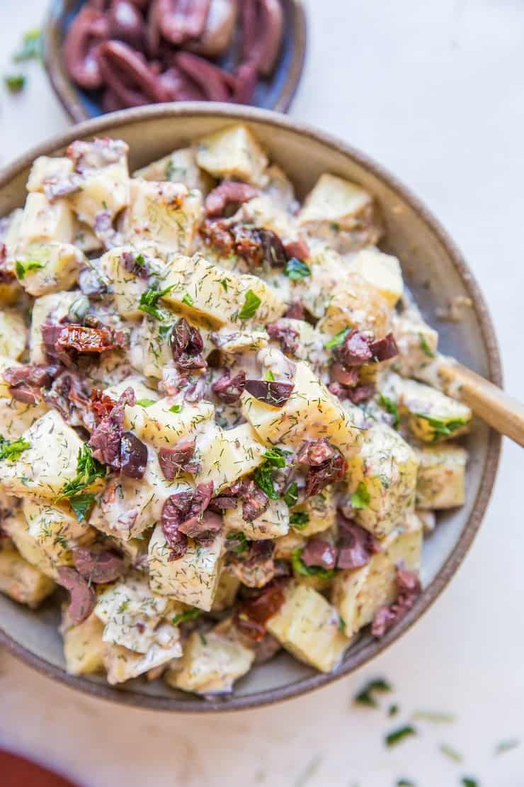 Greek Potato Salad - a healthier potato salad recipe with cider vinaigrette, sun-dried tomatoes, kalamata olives, dill and parsley - an amazing side dish recipe for picnics and BBQs